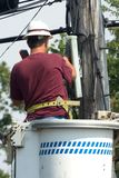 Lineman talking on a touchtone Stock Images