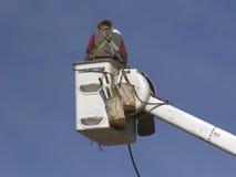 Lineman05. Linemen restring power lines from lift bucket Stock Photo