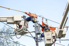 Linemen Repairs Electricity Distribution Lines From An Elevated Stock Images