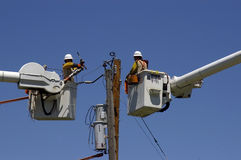 Linemen at Work Stock Photography