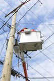 Linemen Working. Linemen hook-up new powerlines on a hydro pole Stock Images