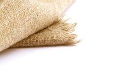 Linen ткань на белой предпосылке Стоковое фото RF