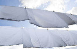 Linen. Hanged next cloded sky background Royalty Free Stock Photography