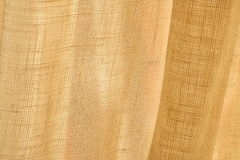 Linen. Close up of beige linen fabric Royalty Free Stock Image