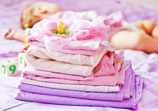 Linen. Baby clothes on the bed, color baby linen Royalty Free Stock Photo
