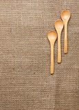 Linen background with spoon Royalty Free Stock Photography
