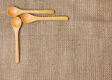Linen background with spoon Royalty Free Stock Photo