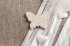 Linen background with white butterfly Stock Photo