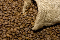 Linen bag with coffee beans. Linen bag with fragrant coffee on beans Royalty Free Stock Image