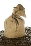 Linen bag and coffee beans. Isolated on white Royalty Free Stock Photo