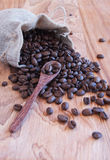 Linen bag with coffee beans, a spoon and oriental. Teapot and cinnamon Stock Images