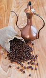 Linen bag with coffee beans, a spoon and oriental. Teapot and cinnamon Royalty Free Stock Images