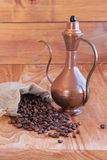 Linen bag with coffee beans, a spoon and oriental. Teapot and cinnamon Royalty Free Stock Photo