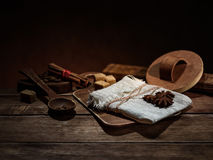 linen bag, coffee, star anise, cinnamon, wooden utensils on the brown background Royalty Free Stock Photos