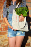 Linen Bag with fresh Lettuce Salad in woman hands Stock Photo