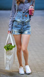 Linen Bag with Lettuce Salad and Smoothies disposable cup in the hands of sexy woman Stock Images