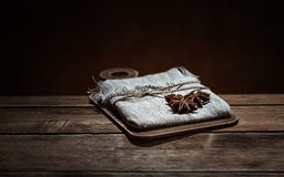 linen bag and star anise on wooden brown Board Stock Image