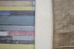 Linen and burlap tablecloth on wooden table. Stock Photo