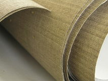 Linen canvas. In roll, pure material Royalty Free Stock Photo