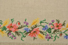 Linen canvas background with embroidery Stock Photo