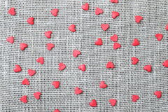 Linen canvas with little red hearts Royalty Free Stock Image
