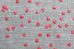 Linen canvas with little red hearts Stock Images