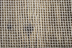 Linen canvas on wooden table Royalty Free Stock Images
