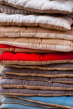 Linen chair pillows pile. Vertical outdoor shot Royalty Free Stock Image