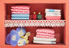 Linen closet. With bottles and flowers in miniature stock photos