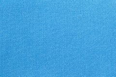 The linen cloth in blue color. Fabric background texture. Detail of textile material close-up. The linen cloth in blue color. Fabric background texture. Detail royalty free stock photography