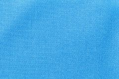 The linen cloth in blue color. Fabric background texture. Detail of textile material close-up. The linen cloth in blue color. Fabric background texture. Detail stock photos