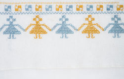 Linen cloth with hand embroidery. Linen napkin with hand-embroidered traditional folk ornament Royalty Free Stock Photography