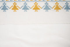 Linen cloth with hand embroidery. Linen napkin with hand-embroidered traditional folk ornament Stock Photos