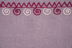 Linen cloth with hand embroidery. Linen napkin with hand-embroidered traditional folk ornament Royalty Free Stock Images