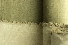 Linen cloth. Burlap, half twisting into a roll Stock Image
