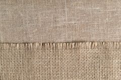 Linen cloth, napkin with the big texture is on the background of the other table cloths royalty free stock images
