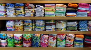 Linen cloth store shelves Stock Images