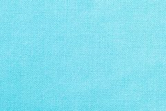 The linen cloth in turquoise color. Fabric background texture. Detail of textile material close-up. The linen cloth in turquoise color. Fabric background texture stock images