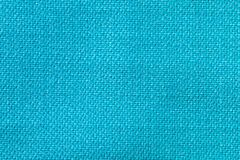 The linen cloth in turquoise color. Fabric background texture. Detail of textile material close-up. The linen cloth in turquoise color. Fabric background texture royalty free stock photo