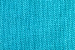 The linen cloth in turquoise color. Fabric background texture. Detail of textile material close-up. The linen cloth in turquoise color. Fabric background texture stock photos
