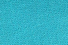The linen cloth in turquoise color. Fabric background texture. Detail of textile material close-up. The linen cloth in turquoise color. Fabric background texture royalty free stock image