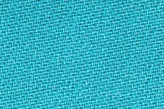 The linen cloth in turquoise color. Fabric background texture. Detail of textile material close-up stock photos