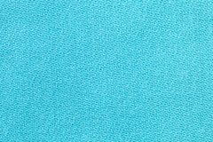 The linen cloth in turquoise color. Fabric background texture. Detail of textile material close-up. The linen cloth in turquoise color. Fabric background texture royalty free stock photos