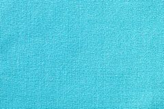 The linen cloth in turquoise color. Fabric background texture. Detail of textile material close-up. The linen cloth in turquoise color. Fabric background texture royalty free stock photography