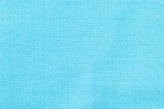 The linen cloth in turquoise color. Fabric background texture. Detail of textile material close-up. The linen cloth in turquoise color. Fabric background texture stock photography