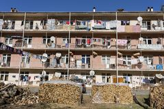 Linen is dried on the balcony in a residential building and near the yard are firewood. Small mountain village near the city of Ba royalty free stock photography