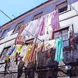 The linen is dried in old portugal town Stock Photos