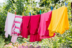 Linen is dried on rope in the garden Royalty Free Stock Image