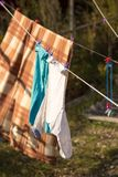 Linen dries on a rope in the open air Stock Images