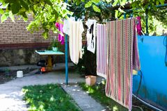 Linen dries on ropes at backyard of country house Royalty Free Stock Photos